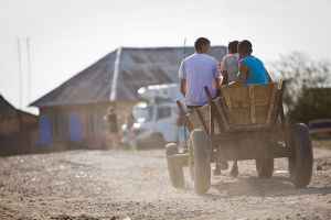 Many times the paved road ends at the entrance to a Roma camp or village