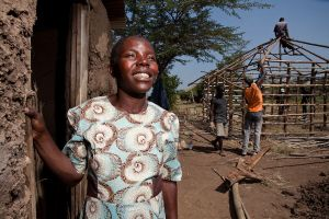 Volunteers are building a new house for this young widow outside Kisumu, Kenya through the Houses of Hope project.